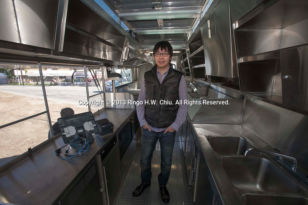 Josh Tang, CEO of Mobi Munch LLC., is photographed in his food truck near downtown Los Angeles. The company owns a fleet of more than 40 trucks, which it leases to lone operators as well as to big companies including Aramark. Several Mobi Munch trucks went into service this fall on college campuses, the fruits of a $7 million Series A funding round in 2011.(Photo by Ringo Chiu/PHOTOFORMULA.com)