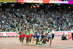 London, August 12 2017 . Mo Farah, Great Britain, keeps an eye on a resurgent Cyrus Rutto, Kenya, in the men's 5000m final on day nine of the IAAF London 2017 world Championships at the London Stadium. © Paul Davey.