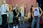 Moscow, Russia, 28/09/2005..The first Millionaire Fair in Moscow at the Crocus City Expo Centre attracted thousands of would-be and existing Russian millionaires to view and purchase a wide range of luxury goods. Mother and bored daughter touring the exhibition..