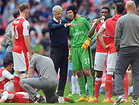 Football - 2016 / 2017 Emirates FA Cup - Semi-Final: Arsenal vs. Manchester City<br /> <br /> Arsenal Manager Arsene Wenger talks to Petr Cech before extra time at Wembley.<br /> <br /> COLORSPORT/ANDREW COWIE