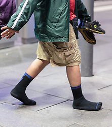 13.09.2015, Hauptbahnhof Salzburg, AUT, Fluechtlinge am Hauptbahnhof Salzburg auf ihrer Reise nach Deutschland, im Bild ein Migrant spaziert mit Socken am Bahnsteig // a migrant walk with socks on the platform. According to reports thousands of refugees fleeing violence and persecution in their own countries continue to make their way toward the EU, just days before Euopean leaders are set to meet in Brussels to discuss a solution to the arrival of so many people, Main Train Station, Salzburg, Austria on 2015/09/13. EXPA Pictures © 2015, PhotoCredit: EXPA/ JFK