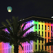 A floating lantern is seen floating into the sky during a vigil at the Dr. Phillips Center for the Performing Arts for the victims of a mass shooting at the Pulse nightclub Monday, June 13, 2016, in Orlando, Florida.  A gunman killed dozens of people in a massacre at the crowded gay nightclub in Orlando on Sunday, making it the deadliest mass shooting in modern U.S. history. (Alex Menendez via AP)