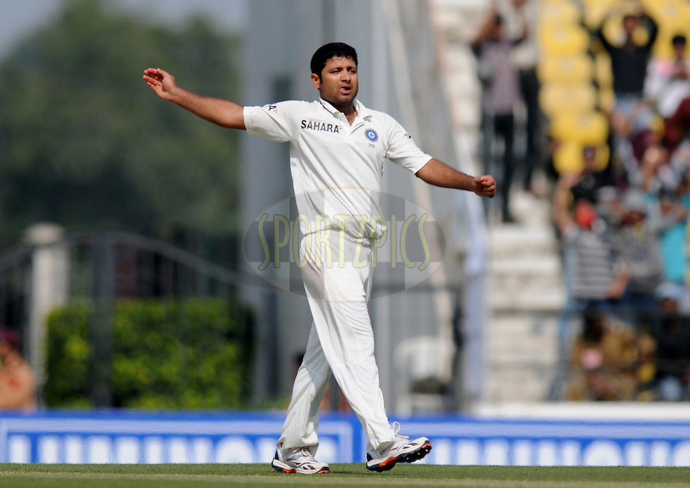 Piyush Chawla of India celebrates the wicket of Graeme Swann of England during day two of the 4th Airtel Test Match between India and England held at VCA ground in Nagpur on the 14th December 2012..Photo by  Pal Pillai/BCCI/SPORTZPICS .
