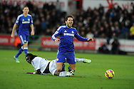 Cesc Fabregas of Chelsea is fouled by Bafetimbi Gomis of Swansea city. . Barclays Premier League match, Swansea city v Chelsea at the Liberty Stadium in Swansea, South Wales on Saturday 17th Jan 2015.<br /> pic by Andrew Orchard, Andrew Orchard sports photography.