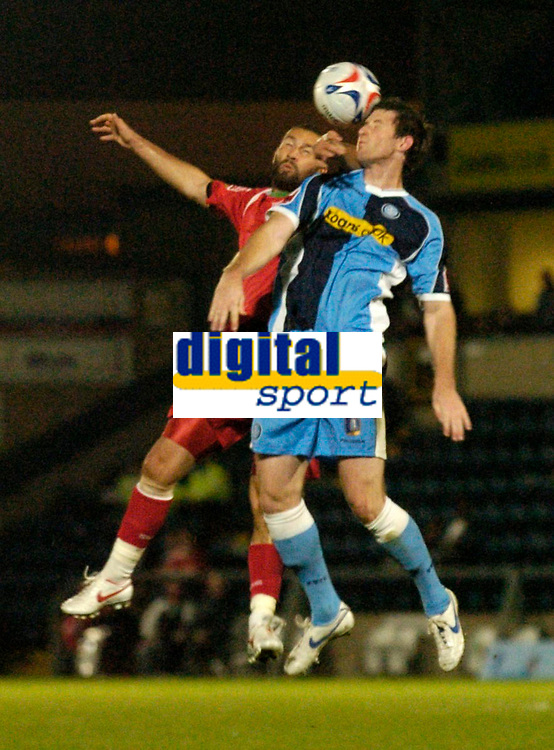 Photo: Richard Lane.<br />Wycombe Wanderers v Swindon Town. Coca Cola League 2. 26/09/2006. <br />Swindon's Christian Roberts and Wycombe's Mike Williamson challenge for the ball.