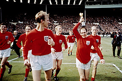 (L-R) England's Martin Peters, George Cohen, Jack Charlton, Bobby Moore, Ray Wilson and Bobby Charlton parade the Jules Rimet trophy around Wembley following their 4-2 victory