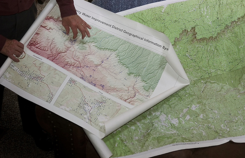 John Benninger uses maps to explain why Pine, Arizona has water shortages, especially during the summer months, when summer homes are full.