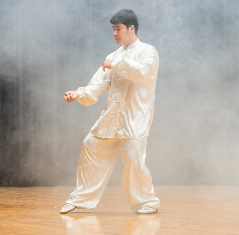 Siming Yang performs Tai Chi during a district wide celebration of the Chinese New Year at Sharpstown International School, February 22, 2014.
