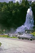 Vauxhall Victor estate car on road by  Steinsdalsfossen waterfall, Norheimsund, Norway in 1970 E68 road sign
