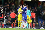 Goalkeeper Iker Casillas of FC Porto smiles at John Terry, the Chelsea captain after the final whistle. UEFA Champions league group G match, Chelsea v Porto at Stamford Bridge in London on Wednesday 9th December 2015.<br /> pic by John Patrick Fletcher, Andrew Orchard sports photography.