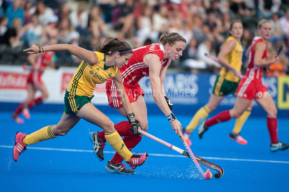 England's Kate Richardson-Walsh is challenged by Kelly Madsen of South Africa during the Final of the Investec London Cup. Lee Valley Hockey & Tennis Centre, London, UK on 13 July 2014. Photo: Simon Parker