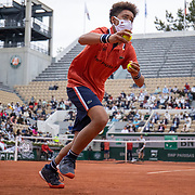 PARIS, FRANCE June 5.  A ball boy retrieves the ball during the Rafael Nadal of Spain match against Cameron Norrie of Great Britain on Court Suzanne Lenglen during the third round of the singles competition at the 2021 French Open Tennis Tournament at Roland Garros on June 5th 2021 in Paris, France. (Photo by Tim Clayton/Corbis via Getty Images)