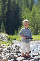 blond little boy by a stream in Montana