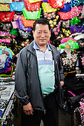 Portrait of a men selling clothes in the center of Seoul.