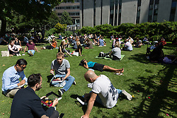 © Licensed to London News Pictures. 12/08/2016. LONDON, UK.  Office workers on their lunchbreak near St Paul's Cathedral during the hot and sunny weather this lunchtime in London this lunchtime.  Photo credit: Vickie Flores/LNP