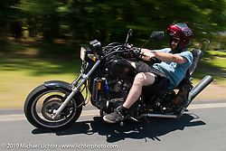 "Coast-to-coast ""Stampeder"" Jeremiah Jack takes a ride Saturday morning during the Smokeout. Rockingham, NC. USA. June 20, 2015.  Photography ©2015 Michael Lichter."