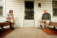 Both retired and single, brothers Julian, 87, left, and Johnnie Wise, 85, have been next door neighbors since 1947. Although they don't speak much, they enjoy their evening ritual of hanging out on Johnnie's front porch.
