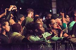 Crowd members. Cape Town Jazz Festival Free Community Concert, 29 March 2017. Greenmarket Square. Photo by Alec Smith/imagemundi.com