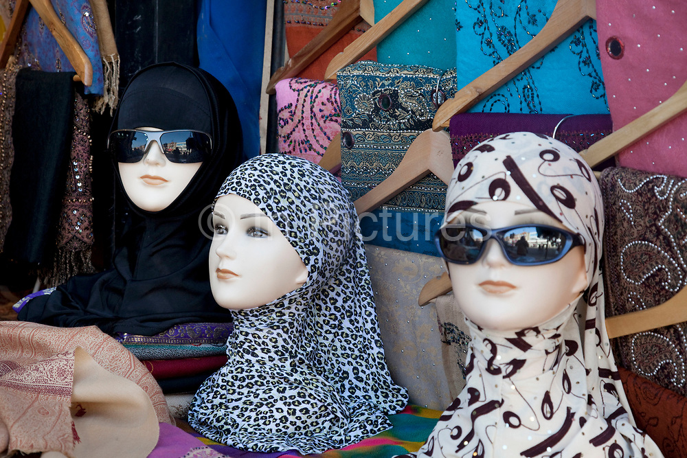Head scarves and sunglasses for sae in Southall in West London, also known as 'Little India' by some, is an area almost completely populated by people from South Asia. Figures show that the area is approximately 50 percent Indian in origin although walking the streets it would appear far higher as the local people go about their shopping in the many shops specialising in goods specific to this culture. The mix of religions is mainly Sikh, Hindu and Muslim.<br /> <br /> Southall is primarily a South Asian residential district. 1950 was when the first group of South Asians arrived in Southall, reputedly recruited to work in a local factory owned by a former British Indian Army officer. This South Asian population grew due to the closeness of expanding employment opportunities. The most significant cultural group to settle in Southall are Indian Punjabis.