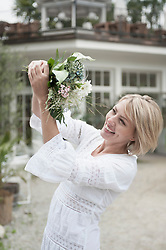 Woman attractive blond catching wedding bouquet