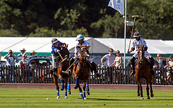 La Dolfina (in white) take on Park Place (in blue) during the polo at the Guards Polo Club, Windsor Great Park, Egham, Surrey.