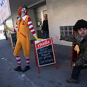 The second day of the Strike WEF march on Davos, 20th of January 2020, Switzerland. Clowns from the Clown Army points out a special WEF lunch offer.  The march started in Schiers and walked the 24 kilomers to Klosters.  The aim is to finish in Davos with a public meeting in the town on the day the WEF begins. The march is a three day protest against the World Economic Forum meeting in Davos. The activists want climate justice and think that The WEF is for the world's richest and political elite only.