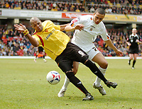 Photo: Leigh Quinnell.<br /> Watford v Luton Town. Coca Cola Championship. 09/04/2006. Watfords Marlon King battles with Lutons Dean Morgan.