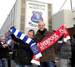 A Liverpool fc fan and Everton fc fan stand outside Goodison Park - Photo mandatory by-line: Dougie Allward/JMP - Tel: Mobile: 07966 386802 23/11/2013 - SPORT - Football - Liverpool - Merseyside derby - Goodison Park - Everton v Liverpool - Barclays Premier League