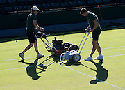 WIMBLEDON - GB -  4th July 2016: The Wimbledon Tennis Championship continues at the All England Lawn Tennis Club in S.E. London.<br /> <br /> The courts are prepared early morning. Line Painting, grass cutting and grass vacuuming.<br /> ©Ian Jones/Exclusivepix Media
