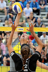 13.07.2014, Beach Village, Gstaad, SUI, FIVB Beach Volleyball Grand Slam Gstaad, im Bild Britta Buethe (GER) gegen Ilka Semmler (GER) // during the FIVB Beach Volleyball Grand Slam Gstaad at the Beach Village in Gstaad, Switzerland on 2014/07/13. EXPA Pictures © 2014, PhotoCredit: EXPA/ Freshfocus/ Claude Diderich<br /> <br /> *****ATTENTION - for AUT, SLO, CRO, SRB, BIH, MAZ only*****