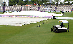 The Ageas Bowl ground staff prepare the pitch for day two of the match between Hampshire and Somerset - Photo mandatory by-line: Robbie Stephenson/JMP - Mobile: 07966 386802 - 22/06/2015 - SPORT - Cricket - Southampton - The Ageas Bowl - Hampshire v Somerset - County Championship Division One