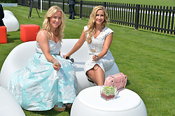 Left to right, HAYLEY RANGE and singer HEIDI RANGE at the Audi International Polo at Guards Polo Club, Windsor Great Park, Egham, Surrey on 26th July 2014.