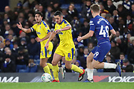 AFC Wimbledon midfielder Anthony Hartigan (8) taking on Luke McCormick of Chelsea (49) during the EFL Trophy match between U21 Chelsea and AFC Wimbledon at Stamford Bridge, London, England on 4 December 2018.