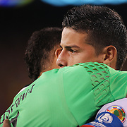 EAST RUTHERFORD, NEW JERSEY - JUNE 17:  James Rodriguez #10 of Colombia hugs goalkeeper David Ospina #1 of Colombia in the penalty shoot out during the Colombia Vs Peru Quarterfinal match of the Copa America Centenario USA 2016 Tournament at MetLife Stadium on June 17, 2016 in East Rutherford, New Jersey. (Photo by Tim Clayton/Corbis via Getty Images)
