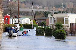 © Licensed to London News Pictures. 02/12/2014<br /> Yalding Flooding a year ago.<br /> <br /> FILE 03/01/2014<br /> <br /> Little Venice resident walking out of the country park  carrying belongings.<br /> The Medway River in Yalding has burst its banks again flooding Large parts of Yalding including Little Venice Country Park and The Lees.<br /> Flood waters are back again in Kent as Gales and heavy rain hit the UK over night.<br /> Photo credit :Grant Falvey/LNP