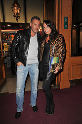 TAMARA ECCLESTONE and OMAR KHYAME at the opening night of Totem by Cirque du Soleil held at The Royal Albert Hall, London on 5th January 2011.