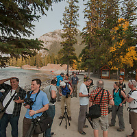 A photography group gathers by the Bow River  in Banff National Park, Alberta, Canada.
