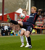 Photo: Leigh Quinnell.<br /> Bristol City v Nottingham Forest. Coca Cola League 1. 31/03/2007. Forests Gary Holt keeps the ball from Bristol Citys Brian Wilson.