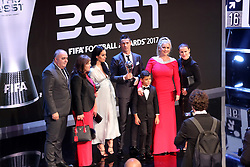 Cristiano Ronaldo on stage with girlfriend Georgina Rodriguez (centre), son Cristiano Ronaldo Jr and Mother Maria Dolores (second left) after winning the FIFA Men's Player of the Year during the Best FIFA Football Awards 2017 at the Palladium Theatre, London.