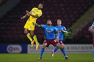 AFC Wimbeldon midfielder Tom Soares (14) climbs well  during the EFL Sky Bet League 1 match between Scunthorpe United and AFC Wimbledon at Glanford Park, Scunthorpe, England on 28 February 2017. Photo by Simon Davies.
