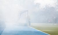 AMSTELVEEN - Rook van het vuurwerk over het hockeyveldtijdens de EHL wedstrijd hockey tussen de mannen van Bloemendaal en Beeston (Eng.). Foto Koen Suyk