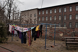 "Clothes hang in the yard of Veronika Sindelárová in Ostrava, Czech Republic on March 1, 2012. She was one of 18 Roma children who were represented in the D.H. and Others v. Czech Republic case, the first challenge to systemic racial segregation in education to reach the European Court of Human Rights. When this case was first brought in 2000, Roma children in the Czech Republic were 27 times more likely to be placed in ""special schools,"" intended for the mentally disabled, than non-Roma children. In 2007, the Grand Chamber of the European Court of Human Rights ruled that this pattern of segregation violated nondiscrimination protections in the European Convention on Human Rights. Despite this landmark decision, little change has occurred: the ""special schools"" have been renamed but follow the same substandard curriculum and Roma continue to be assigned to these schools in disproportionate numbers. The process of integration has barely begun."