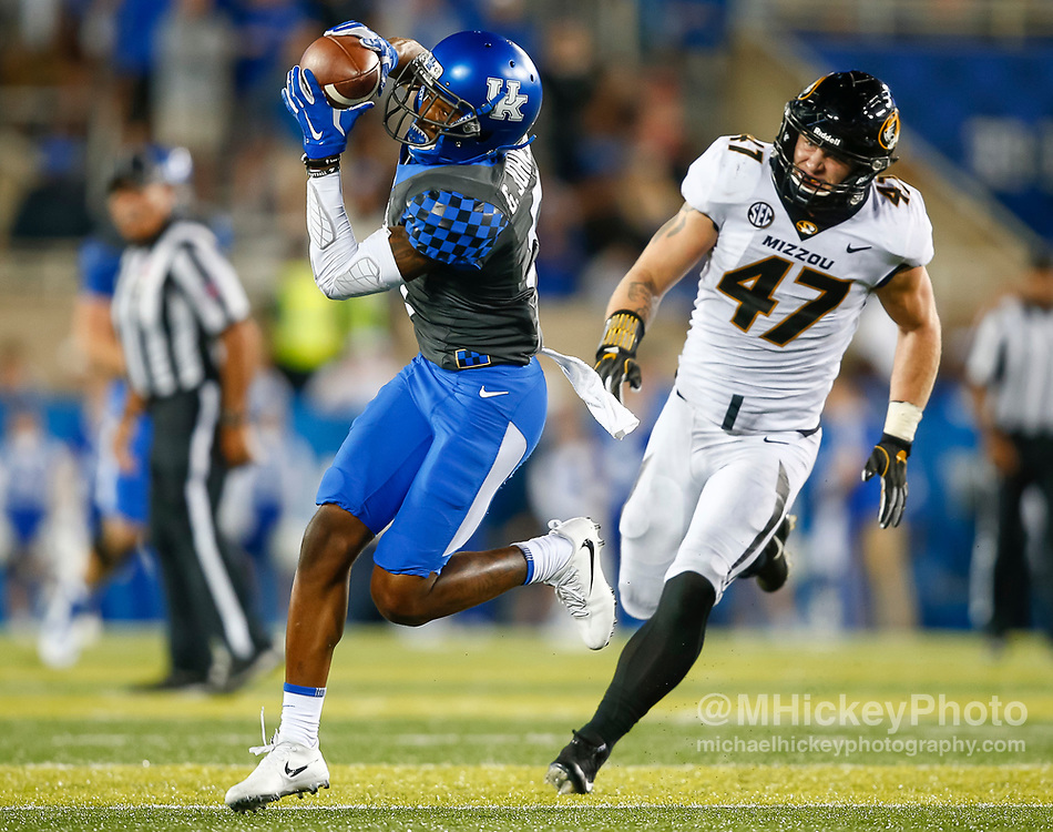 LEXINGTON, KY - OCTOBER 07: Garrett Johnson #9 of the Kentucky Wildcats makes a catch and would go on to score a touchdown as Cale Garrett #47 of the Missouri Tigers trails at Commonwealth Stadium on October 7, 2017 in Lexington, Kentucky. (Photo by Michael Hickey/Getty Images) *** Local Caption *** Garrett Johnson; Cale Garrett
