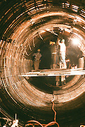 Alaska. Iron workers construct a tunnel on a sewer line.