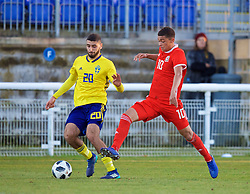 BANGOR, WALES - Saturday, November 17, 2018: Wales' Brennan Johnson (R) and Sweden's Aiham Ousou during the UEFA Under-19 Championship 2019 Qualifying Group 4 match between Sweden and Wales at the Nantporth Stadium. (Pic by Paul Greenwood/Propaganda)