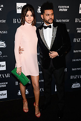 Selena Gomez (wearing Valentino) and The Weeknd attend Harper's BAZAAR Celebration of 'ICONS By Carine Roitfeld' at The Plaza Hotel presented by Infor, Laura Mercier, Stella Artois, FUJIFILM and SWAROVSKI on September 8, 2017 in New York City. 08 Sep 2017 Pictured: Selena Gomez, The Weeknd. Photo credit: MEGA TheMegaAgency.com +1 888 505 6342