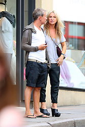 Meg Mathews out shopping with a mystery man in north London. Noel Gallagher's ex-wife wearing a grey t-shirt, pair of black 3/4 length trousers and black shoes was all smiles as she walks arm in arm around Hampstead with her man. London, UK. 15/08/2012<br />