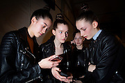 TORONTO, ON - MARCH 14: Models check out their phones and each other before the Sid Neigum show during Toronto Fashion Week in Toronto, Ontario. Toronto Star/Todd Korol
