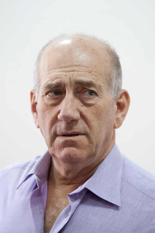 Former Prime Minister of Israel Ehud Olmert is seen at the courtroom of the District Court in Jerusalem, Israel, on September 20, 2011, during his trial. Olmert's indictment included the following counts: obtaining by fraud under aggravating circumstances, fraud, breach of trust, falsifying corporate documents, and tax evasion. The indictment refers to three out of the four corruption-related cases standing against him: 'Rishon Tours', 'Talansky' (also known as 'Money envelopes' affair), and the 'Investment Center'. On July 10, 2012 Olmert was convicted on one count of breach of trust over the 'Investment Center' case, but exonerated over the 'Talansky' and 'Rishon Tours' affairs.