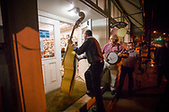"""FLOYD, VA - APRIL 1:  Local musicians from the group """"Barbershop Grass"""" enter the Floyd country store to play for the Friday night jamboree on April 1, 2005.  The group has played every Friday night at the country store for the last 20 years."""